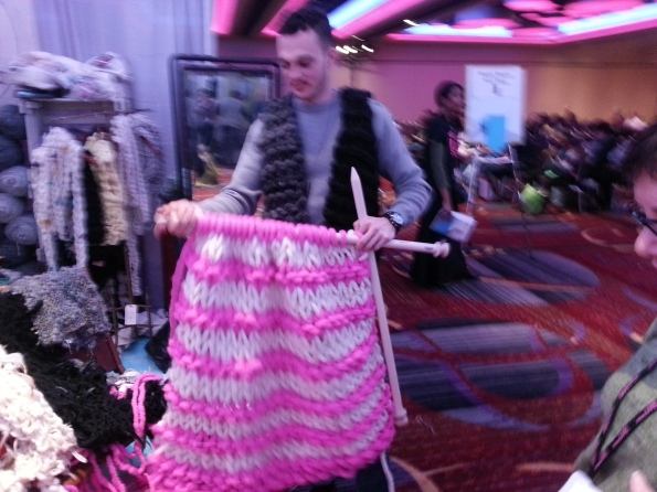 Sorry for the blur, couldn't stop giggling. Note his vest, also made from enormous yarn