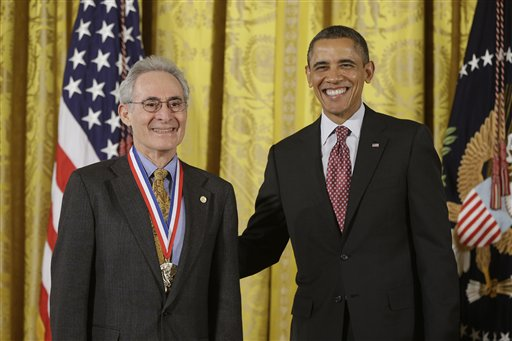 President Barack Obama awards the National Medal of Science to Dr. Barry Mazur of Harvard University, Friday, Feb. 1, 2013, during a ceremony in the East Room of the White House in Washington. The awards are the highest honors bestowed by the United States Government upon scientists, engineers, and inventors. (AP Photo/Charles Dharapak)